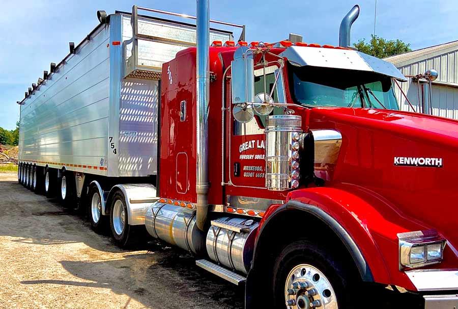 red kenworth semi truck cleaned by fleet cleaner of grand rapids, mi