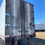 michigan truck washing company cleans dirty semi trailer